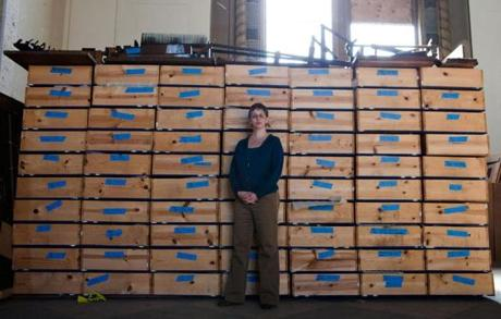 The Rev. Ashlee Wiest-Laird has only a couple of weeks to find a place to store the huge organ - pipes, piles of ribs and boards, and a tower of 70 long crates that house thousands of pieces.